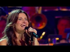 """You can order the full DVD today on Amazon: http://bzz.is/IdinaMenzel!     Enter to win a meet & greet with Idina on her upcoming tour at http://www.facebook.com/IdinaMenzel    Idina Menzel performs """"Defying Gravity"""" from the Broadway smash """"Wicked"""" with the Kitchener-Waterloo Symphony, conducted by Marvin Hamlisch.    Idina may be coming to a city near you! Visit http://www.IdinaMenzel.com for tour dates."""