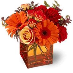 *I like this size, for some tables and LOVE the colors!* Red and Orange Flower Centerpiece in Glass Square Vase