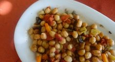 Baked Ikarian Chickpeas Ikarians eat a variation of the Mediterranean diet, with lots of fruits and vegetables, whole grains, beans, potatoes and olive oil. Olive oil contains cholesterol-lowering mono-unsaturated fats. Try this delicious Baked Chickpeas recipe. And don't forget the olive oil!