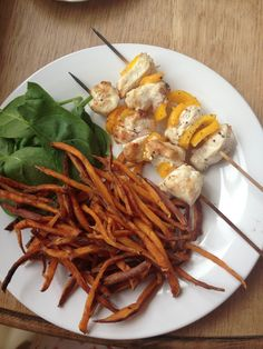 Sweet potato fries, chicken kebabs and spinach.