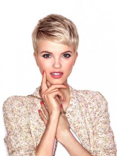 Short blonde hair and pink makeup and nails