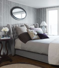 Use a tufted headboard and soft lilacs and grays to create a calming space.   - ELLEDecor.com