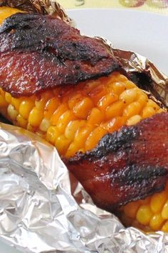 You'll never eat corn any other way! Ingredients 10 ears corn, husked and cleaned Cajun seasoning to taste salt and black pepper to taste 1 pound) package sliced bacon 10 sheets aluminum foil Instructions Preheat Grilled Bacon Wrapped Asparagus, Bacon Wrapped Corn, Corn Recipes, Side Dish Recipes, Vegetable Recipes, Easy Recipes, Popular Recipes, Chicken Recipes, Side Dishes