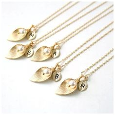 "ED33 Gold Calla Lily Faux Pearl Initial Necklace ‼️PRICE FIRM‼️   FABULOUS!!!!  Lightweight & easy to wear!  Lily is approximately 1.1"". Necklace is approximately 18"" long. Available in the following letters: L, M, R, S, & T.  Please check out my closet for many more items including scarves and designer clothing. Jewelry Necklaces"