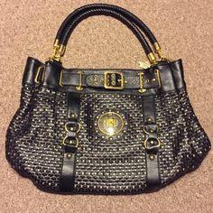 Versace Handbag Black and gold Versace handbag. Gently used. Great condition, medium sized bag. Versace Accessories