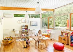 The expanded west end followed the existing layout and incorporated similar wood windows found elsewhere in the home. The children's bedrooms now have direct access to the light-filled playroom, which opens to the front yard. #dwell #homerenovation #midcenturymodern #midcenturydesign Wood Columns, Wood Windows, Mid Century Ranch, Mid Century House, 1950s House, Kitchen And Bath Remodeling, Black And White Tiles, Street House, Showcase Design