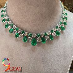 Complete the look of royalty with this diamond necklace fringed with lush emerald gemstone