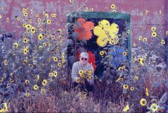 Andy Warhol with sunflowers