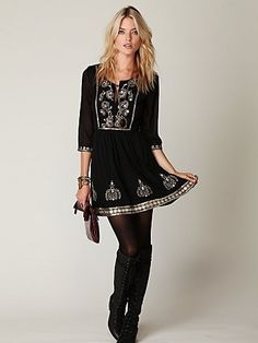 Bohemian/Mexican style dress, given a sexy edge with tights and boots. Love.