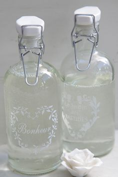Find some clear lager bottles (grolsch?) to etch like this for linen water. so pretty!
