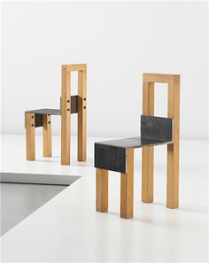 JONAS BOHLIN Pair of 'Sto' chairs, 1990  Oak, iron. Each: 94.3 x 31.6 x 53.5 cm (37 1/8 x 12 1/2 x 21 1/8 in) Number 18 from the edition of 70. One seat incised and dated with 'STO 18 / 70 jONAS BoHLiN 1990'