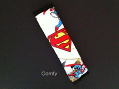 For all you SUPERMAN lovers...make every ride a more enjoyable one with a Comfy seat belt cover. by Comfy Accessories