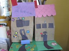 inspired by a pin.  paper bag house.  easy and fun to play with when done- we've made lots of these- great busy craft