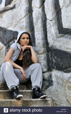 Young Person (teenagerl) In Hip Hop Style Siting On Stairs In Front Stock Photo, Royalty Free Image: 27754755 - Alamy