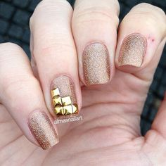 Accent nail embellished with gold square nail art studs #nailart