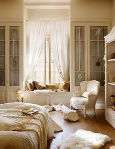 Romantic White Bedroom with a Window Seat
