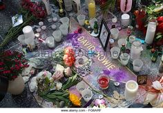 A memorial on David Bowie's star on The Hollywood Walk of Fame in Hollywood. The music and fashion icon David Bowie died January 10th at the age of 69 after a battle with cancer. (Stock Photo) Contributor: WENN Ltd / Alamy www.alamy.com  http://www.alamy.com/stock-photo-a-memorial-on-david-bowies-star-on-the-hollywood-walk-of-fame-in-hollywood-96026547.htm