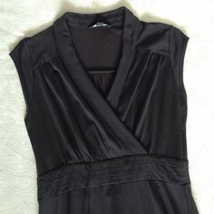 """Banana Republic Black Dress Perfect casual day dress. Loved this dress and wore it a lot. 70% silk/30% cotton. Black is faded but no snags or marks. 39"""" from shoulder to hem. Banana Republic Dresses Midi"""