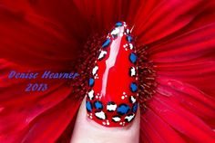 4th of July Nails . Gel Polish with cheetah print done on top of it with water based acrylic paints and then top coated again with Gel polish Top Coat and cure again .