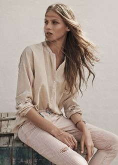 Beige jacquard blouse, pale pink jeans, lovely lighting