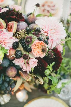 This proves how sweet the romance is between fruit and flowers. Beautiful rich Dahlia's mixed with grapes, and sumptuous figs and blackberries. Perfect!