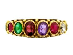 A gold 'REGARD' ring, c.1850; the first letters of the stones (ruby, emerald, garnet, amethyst, ruby and diamond) spell 'regard'. (Berganza)