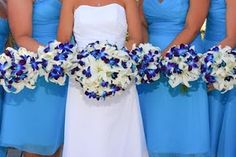 Beautiful Blue Orchid and White Lily Bouquets