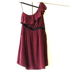 Gianni Bini Silk L dress In great condition burgundy silk dress purchased from Dillard's last year. Worn only a few times and dry cleaned the last. Has black elastic band across middle and side zipper. Also a cute ruffled one shoulder. Gianni Bini Dresses