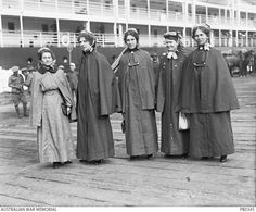 Nurses prior to boarding HMAT Orsova (A67).  Identified are (left to right): Sister Mary Florence Kitson; Staff Nurse Victoria Dorothy Christenson; unidentified; possibly Staff Nurse Annie McHardy; ...