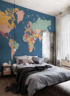Explore and learn about the world with this beautiful map mural. Bright block colours contrast wonderfully against the sophisticated navy blue ocean. Ideal for modern living spaces as well as kid's bedrooms and playrooms. Location: Aubergine Studios