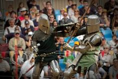 Abbey Medieval Tournament spectators watch as combatants take up arms on the field of valour