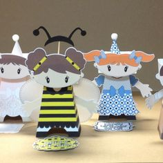 KupKake Kids are unique, paper people that hold individual cupcakes for display.  Erin Borges Event Design - designer, visionary, marketing; DebDen Designs - engineer, creator, production.