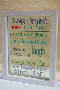 Cut out vinyl with silhouette cameo and apply to glass frame