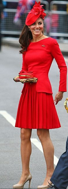 Catherine, Duchess of Cambridge's Alexander McQueen pleated skirt dress has previously been worn on previous occasions, most famously on the royal barge during the Diamond Jubilee river pageant of 2012.