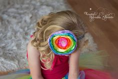 This listing is for the headband only!  Beautiful handmade rainbow satin layered flower accented with rhinestone piece attached to elastic