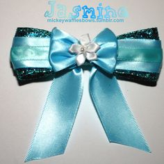 This bow is inspired by Princess Jasmine from Disneys Aladdin. Its a medium 4 inch bow with some sparkle! Its embellished with a white fabric