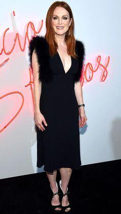 Julianne Moore in a black Ferragamo midi dress with fur shoulders