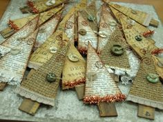 Paper trees : love the ruler trunks, old book pages, and sewn on buttons / dragonfly dreamers Christmas Ornaments To Make, Noel Christmas, Christmas Paper, Homemade Christmas, Rustic Christmas, Winter Christmas, Vintage Christmas, Christmas Decorations, Xmas