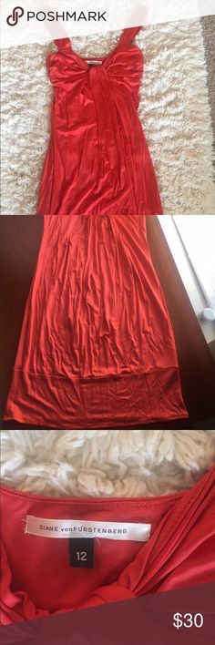 DVS Burnt Orange Cocktail Dress Size 12 Used Very Good Condition (UVGC) cocktail dress. The pictures doesn't do this dress any justice. It's 😍😍 in person. Small mark on the bottom hem and a very light blemish on the body of dress but could very well be washed out. Diane von Furstenberg Dresses Midi