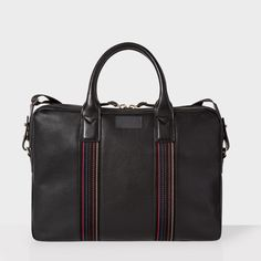 - Paul Smith men's 'City Webbing' slim business folio made from black pebble embossed leather with two handles, a removable adjustable shoulder strap, stud protected base, multi-stripe webbing and a zip fastening compartment. - This business folio featur