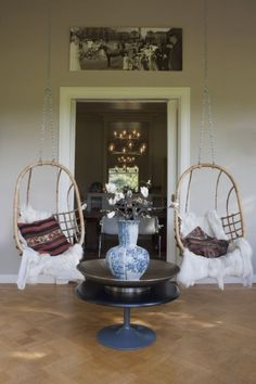 love hanging chairs on the patio. Pier 1 has hanging chairs that i'm in love with!