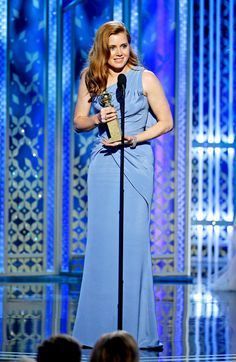 Amy Adams won her first Golden Globe in 2014 for her role in American Hustle—and returned to the stage once again Sunday evening, this time to accept the Best Actress in a Motion Picture Comedy award for her role in Tim Burton's Big Eyes.