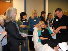 Paul demonstrating a shoulder reflex on Sue Ear Reflexology, Northern California, Conference, Oregon, Workshop, Shoulder, Atelier, Work Shop Garage