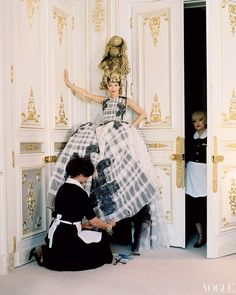 "Room Service - ""Gianni's [Versace] shows were amazing—and sooo convenient. Walk downstairs, go to work: Love that!"" says Moss, with housekeepers Khadidja Fakri and Lollie Bacete (standing). Dior Haute Couture embroidered silk dress. Headpiece created by Julien d'Ys."