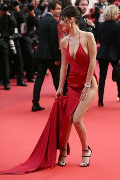 """Bella Hadid during the """"The Unknown Girl"""" (La Fille Inconnue) premiere wearing a dangerously revealing red Alexandre Vauthier gown, Cannes, 2016 Bella Hadid, Sexy Outfits, Photo Cannes, Palais Des Festivals, Red Gowns, Alexandre Vauthier, Celebrity Beauty, Celebrity Style, Sexy Legs"""