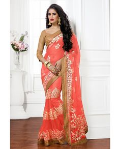 Peach thread embroidered sari with golden border   1. Peach net embroidered sari2. Comes with matching unstitched blouse material