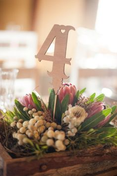 Windmills & Bunting Farm Wedding at Olive Grove | Confetti Daydreams - Rustic-looking plant and flower table centrepiece and table number ♥ #Wedding #Bunting #Windmills ♥  ♥  ♥ LIKE US ON FB: www.facebook.com/confettidaydreams  ♥  ♥  ♥