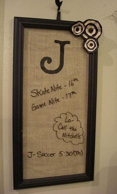 i love this idea- looks way nicer than the usual dry erase board & tacky calendar hanging somewhere in the house