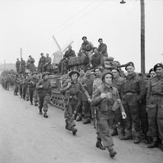 Churchill tanks of 6th Guards Tank Brigade and troops of the 10th Highland Light Infantry, 15th (Scottish) Division, during the assault on Tilburg, Holland, 28 October 1944.