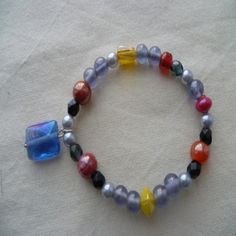 Handmade Jewellery - Bracelet 4.99. A gift idea by karen chatham found on www.MyOwnCreation.co.uk: A lovely beaded bracelet made with amber and grey beads with a blue dropper. The bracelet is stretchy and would fit a small to medium, supplied in a silver organza gift bag.